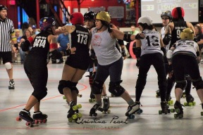 Roller derbying like an amateur with the Veteran city Rollers (#13 Wildebeest) Photo: Christina Peach